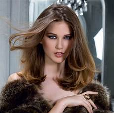 simple one length hairstyle with flowing over the shoulder length hair
