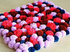 diy pom pom rug easy to make with fluffy wool yarn