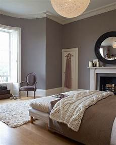 cozy contemporary bedroom with warm colors love the