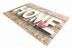 tappeto zerbino tappeto zerbino digitale con scritta home su fondo legno