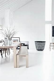 white walls and in floor storage make this creative house design decordots white interiors