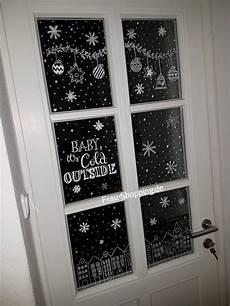 weihnachtliche fensterbilder mit kreidestift frau
