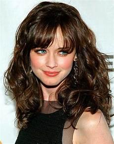 Wavy Medium Hairstyles With Bangs