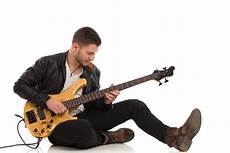 how to play a bass guitar how to hold a bass guitar learn to play