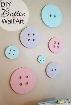 diy button wall art for a sewing craft room sewing