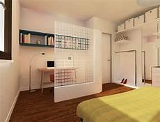 soggiorno da letto una quinta semitrasparente per separare una zona studio