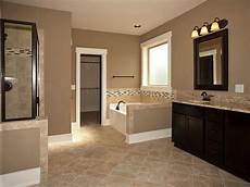 master bathroom add tile flooring frame the mirror stain the cabinets change light fixtu