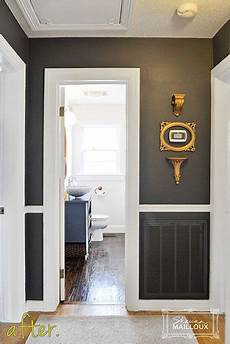 dark charcoal gray hallway like the dark paint with white trim contrast for my home grey
