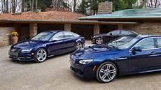 Bmw 650i Vs Audi S7 2013 audi s7 vs 2013 bmw 650i xdrive gran coupe vs 2013