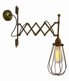 scissor arm extendable caged wall light extending to a maximum reach of 550mm