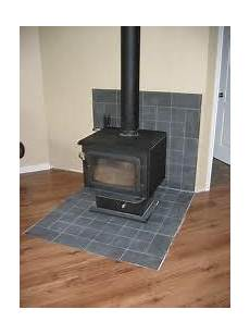 remodeling a stove wall shield with river rock faux rock pinterest stove wall
