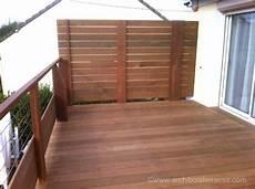 pare vent bois terrasse bois en hauteur sur pilotis avec pare vue et