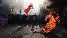 indonesia s leader faces student protests and crises