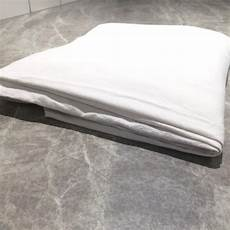 how to fold a fitted bed sheet good housekeeping