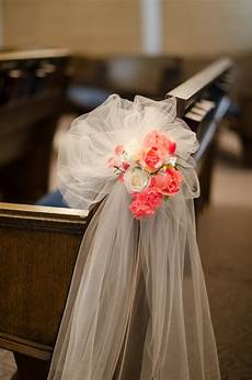 wedding aisle decoration pew bow coral flowers pink white