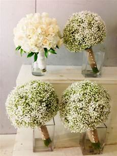 i like the idea of baby s breath bouquets for the smaids to compliment a white rose