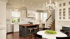kitchen design using symmetrical cabinetry and range hood with display shelf and ornamental