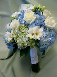 blue hydrangea white freesia white roses wedding bouquet
