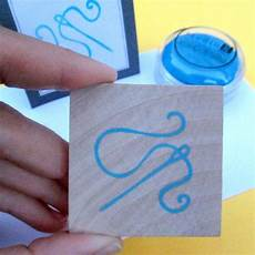 a needle and thread carved rubber st by