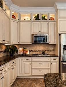 i love this color scheme tropical brown granite with creme cabinets and tumbled travertine