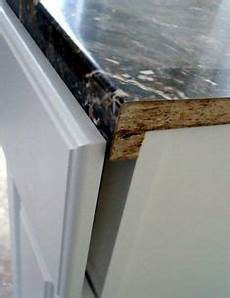 this article details how to install laminate countertop sheets over existing laminate home