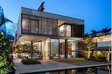 modern glass house open landscaping decorations galeria de casa villa lobos una arquitetos 9