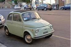 pale green fiat 500 on in rome italy