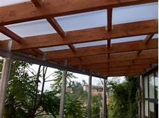tettoia in legno lamellare pensilina in ferro legno lamellare e copertura in