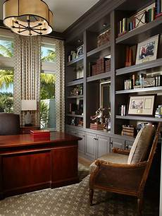 beautiful home office furniture with a glossy mahogany desk and expansive gray built ins