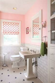 adorable pink s bathroom with pink paint color paired with subway tile with dark