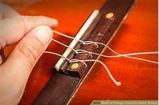 How To Change Classical Guitar Strings With Pictures
