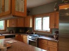 need help with honey maple cabinets and paint colors