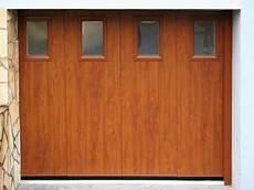 porte de garage coulissante bois porte de garage en bois coulissante les menuiseries