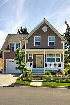 brown exterior yellow door porch landscaping house paint exterior brown roofs