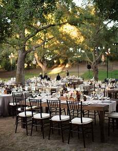 outdoor garden elegant garden wedding long table reception next exit wedding photograph