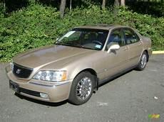 1999 naples gold metallic acura rl 3 5 sedan 38010144
