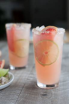 paloma cocktail with chili lime salt bourbon and honey