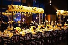 yellow black white sunflower theme wedding reception with custom monogrammed chairs photo