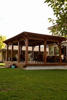 backyard deck pergola lattice fullwrap cantilever roof western timber frame