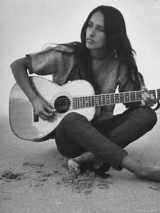 joan baez guitar folk singer joan baez strumming guitar on the near home premium photographic print