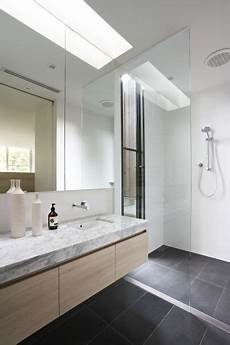 light coloured wall hung timber vanity with a stone top in an on trend colour scheme of grey and