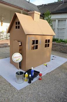 Painting A Cardboard House Is A Activity For The