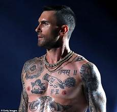 twitter is convinced that one of adam levine s tattoos