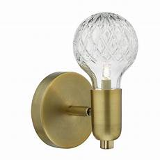 soft aged brass single wall light with decorative cut