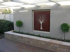 Home Outside Wall Decor Ideas by Garden Wall Galleries Overwrought Garden