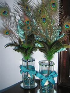 wedding centerpiece ideas with peacock feathers diy peacock feather centerpieces for a pretty glow add