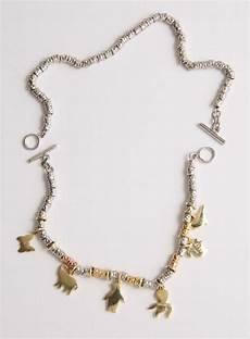bracciali dodo pomellato catalogo pomellato coppia di bracciali con sei ciondoli argenti