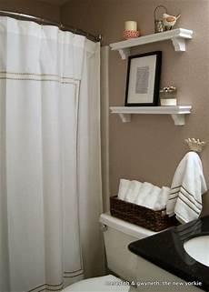 small but lovely beige bathroom with white shower curtain