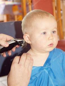 little boy getting his first haircut