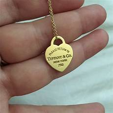 co small return to gold pendant and